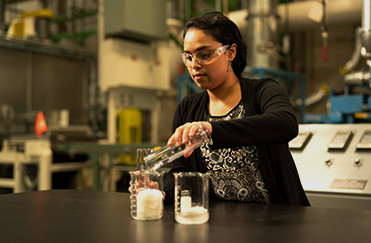 Woman testing chemicals
